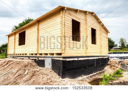 Construction of a new wooden house in summer cloudy day
