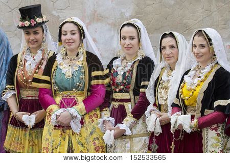 CAGLIARI, ITALY - May 1, 2014: 358th Religious Procession of Sant'Efisio - Sardinia - group of beautiful girls in traditional Sardinian costume