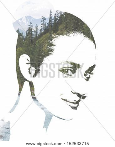 Double exposure portrait of a beautiful young woman and forest.
