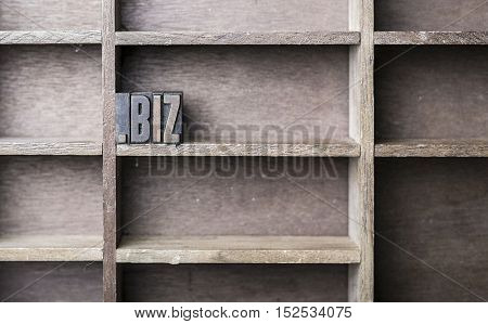 old wooden printers type forming the word .biz