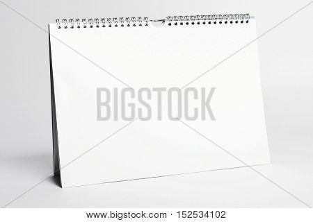 white blank calendar mockup with spiral binding
