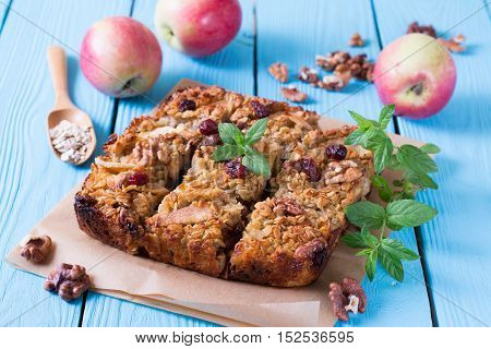 Baked oatmeal with apples on a wooden background