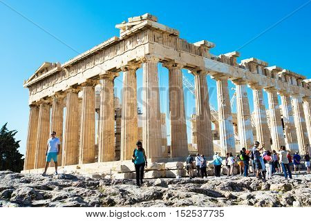 Athens, Greece - October 14, 2016: Tourists near Parthenon temple in Acropolis in Athens, Greece