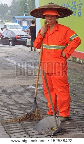 Street Worker Is Cleaning Side Walk With Broom Tool