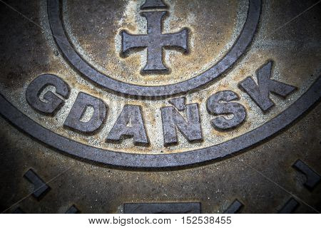 Gdansk weathered metal sign in northern Poland