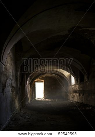 Old abandoned horse stables without any animals.