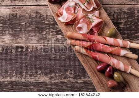 Curled Slices Of Delicious Prosciutto With Spice  Italian Cuisine