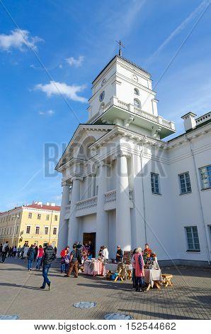 MINSK BELARUS - OCTOBER 1 2016: Unidentified people are near Minsk City Hall Belarus