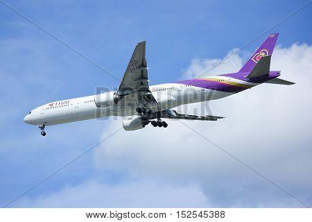 CHIANGMAI, THAILAND -OCTOBER 7 2015: Boeing 777-300 HS-TKE of Thaiairway. landing to Chiangmai airport from Bangkok Suvarnabhumi, thailand.
