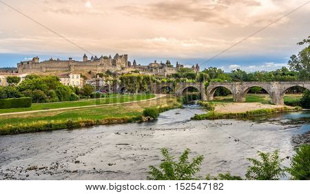 CARCASSONNE,FRANCE - AUGUST 29,2016 - Evening view at the fortified city of Carcassonne with Pont Vieux crossing L Aude river. Carcassonne is a fortified French town in the Aude department.