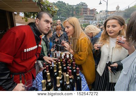 TBILISI, GEORGIA - OCT 16, 2016: Conversation about wine tasting during popular georgian festival Tbilisoba on October 16, 2016. Tbilisoba is traditional festival in capital of Georgia from 1979