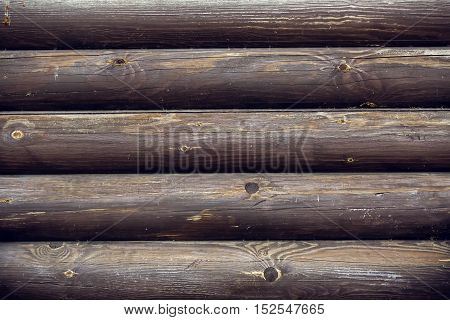 grey horizontal wooden beam from the wall of the old building