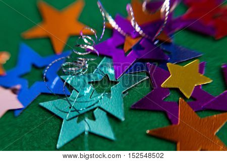 small multi-colored stars on a green background