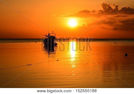Fishing Boats in harbour at sunset and twilight sky background ,Phuket Thailand
