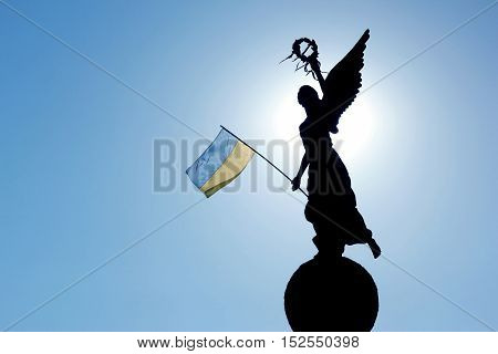 the silhouette in the sunlight of the monument of independence in Kharkov Ukraine