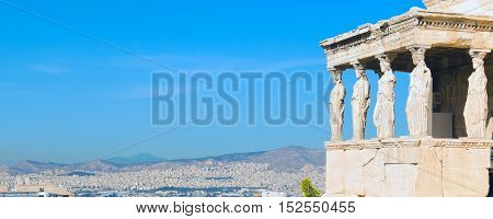 Banner panoramic background with Acropolis, Erechtheum Temple in Athens, Greece and blue sky
