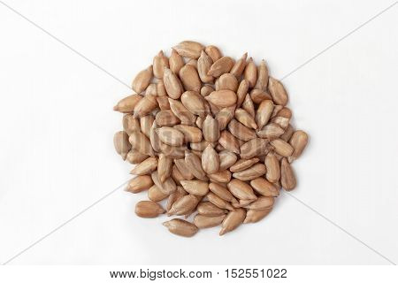 the peeled sunflower seeds on white background