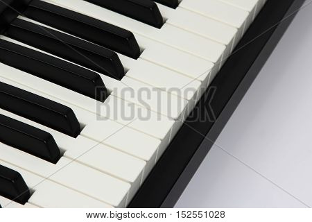 the piano keys closeup on white background