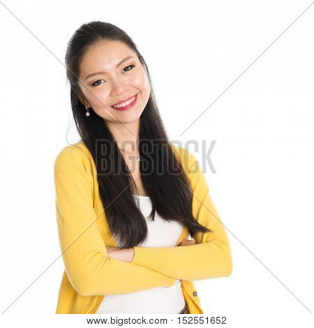 Portrait of Asian woman, smiling looking at camera, standing isolated on white background.