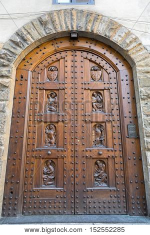 Beautiful old vintage engraved wooden door in Florence, Italy