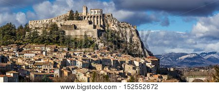 Sisteron rooftops with its Citadel and fortifications (panoramic). Alpes de Haute Provence Southern Alps France