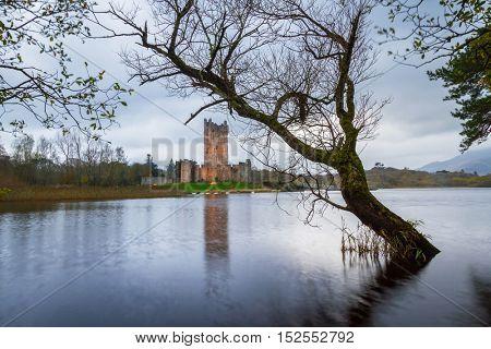 Ross Castle reflected at the lake at Killarney, Co.Kerry, Ireland