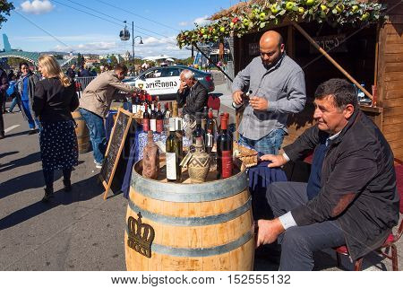 TBILISI, GEORGIA - OCT 16, 2016: Owners of private wine companies present their wine for tasting at festival Tbilisoba on October 16, 2016. Tbilisoba is traditional festival in capital of Georgia from 1979
