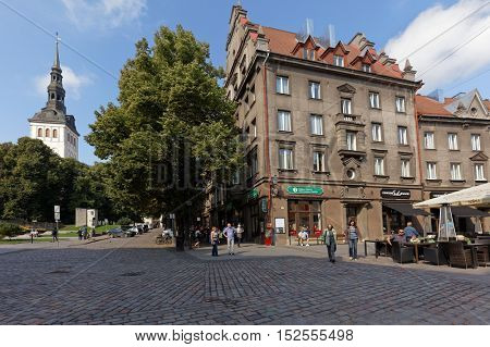 TALLINN, ESTONIA - AUGUST 20, 2016: People at the tourist information center. The Old Town is one of the best preserved medieval cities in Europe and is listed as a UNESCO World Heritage Site
