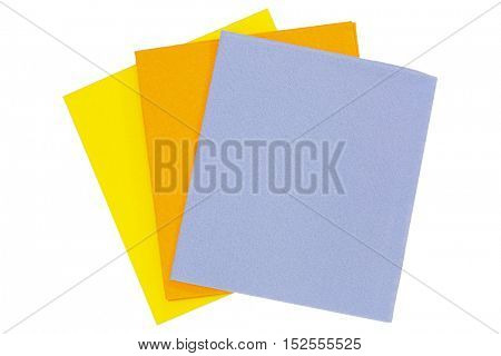 Closeup of super Absorbent fabrics in orange blue yellow color. Absorbing cloth isolated on white