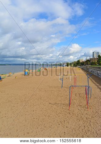 Samara, sports playground on city beach on the shores of the Volga River at cloudy autumn day, beautiful cumulus clouds