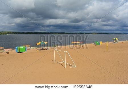 Samara, goal for beach football on city beach on the shores of the Volga River in anticipation of thunderstorm, beautiful cumulus clouds before rain