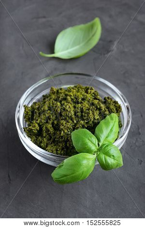 Pesto In Glass Bowl And Fresh Basil Leaves