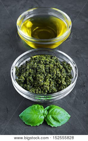 Pesto And Olive Oil In Glass Bowls And Fresh Basil Leaves