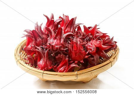 Roselle fruits in bamboo basket isolated on white