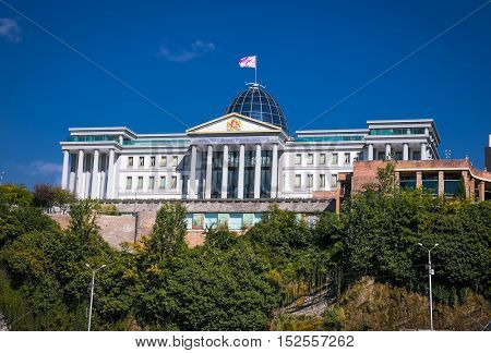 TBILISI, GEORGIA-OCT 2, 2016: Georgian flag flies boldly above the  glass dome of the Georgian Presidential Palace in the nation's capital, Tbilisi, Georgia,Oct 2, 2016. Europe.