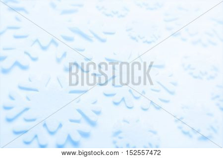Christmas winter background from decorative gentle snowflakes