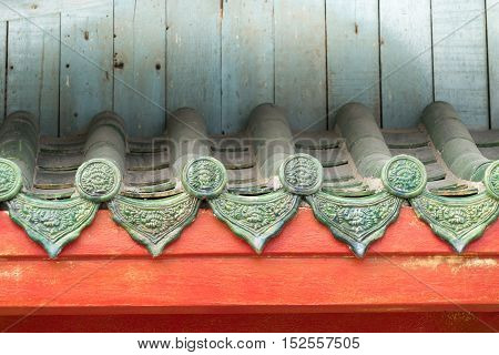 Texture of Chinese style old roof and blue wooden wall as background .