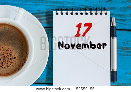 November 17th. Day 17 of month, calendar on white coffee cup at Network Systems Analyst workplace background. Autumn time.
