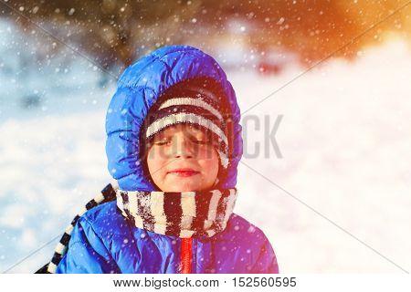 little boy enjoy snow in winter nature, kids winter activities