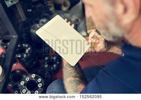 Auto Repair Shop Owner Checking Tablet Concept