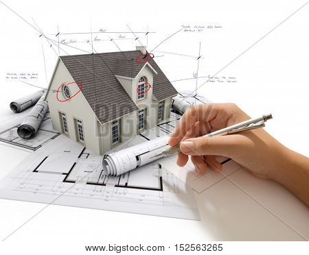 Hand writing corrections on a house model with blueprints 3D rendering