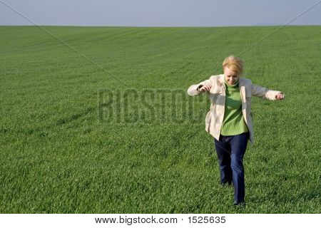 Woman On The Field At Springtime
