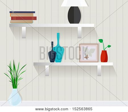 Furniture. Wall with shelves, books, picture, vases.