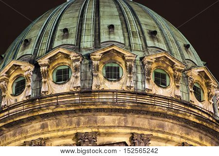 Fragment of old cathedral dome at night