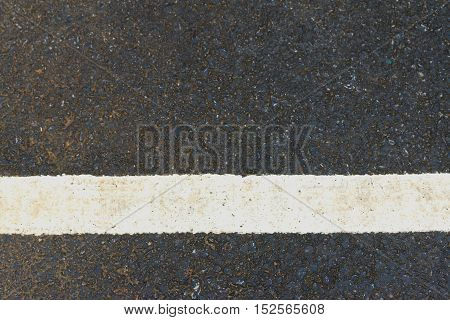 asphalt texture with white line, on road