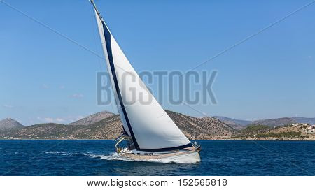 Ship yachts with white sails in the open Sea. Luxury Sailing.