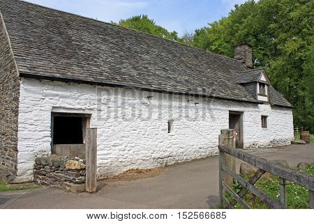 Historic farmhouse building with whitewadhed walls in Wales