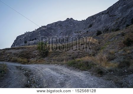 Ruins of medieval Genoese fortress on top of a mountain in Crimea