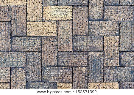 Herringbone style block pavement. Background texture.