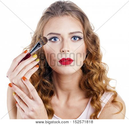 Close up portrait of attractive caucasian smiling woman blond isolated on white studio shot lips toothy smile face hair head and shoulders looking at camera brush makeup